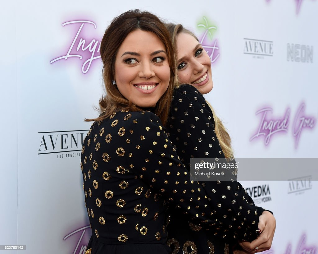 Actors Aubrey Plaza (L) and Elizabeth Olsen attend the Los Angeles Premiere of 'Ingrid Goes West' presented by SVEDKA Vodka and Avenue Los Angeles at ArcLight Cinemas on July 27, 2017 in Hollywood, California.