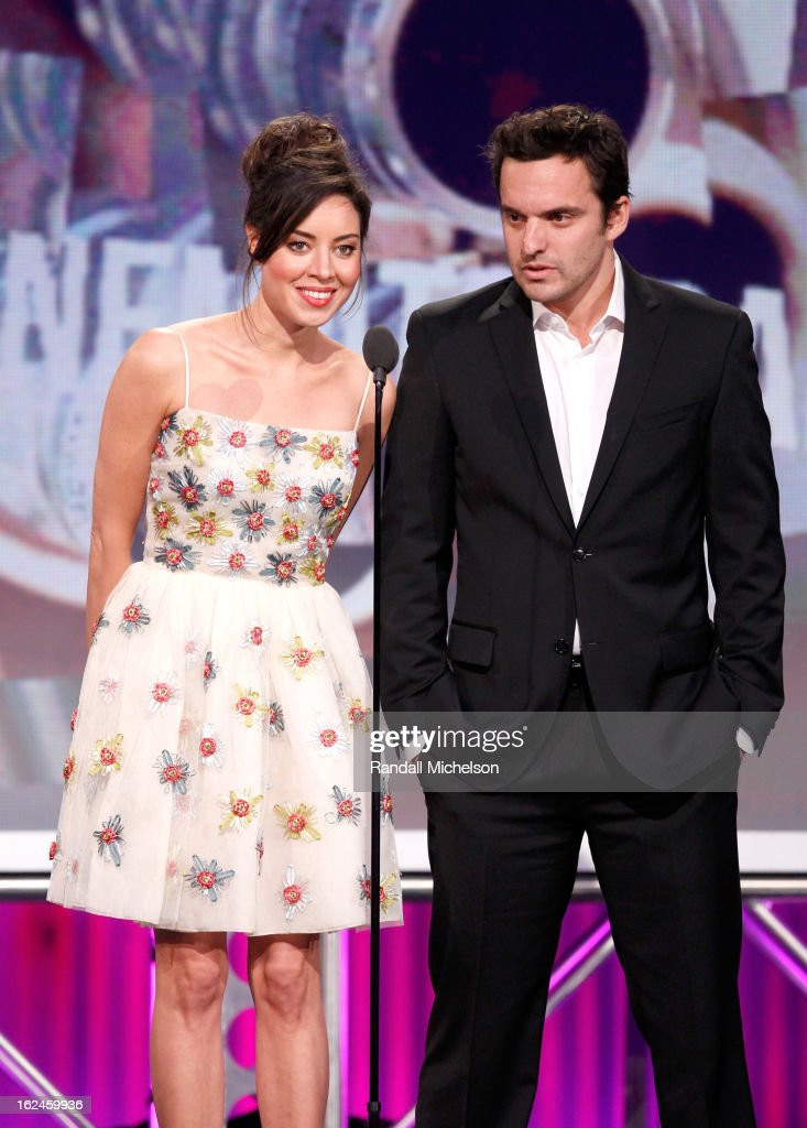 Actors <a gi-track='captionPersonalityLinkClicked' href=/galleries/search?phrase=Aubrey+Plaza&family=editorial&specificpeople=5299268 ng-click='$event.stopPropagation()'>Aubrey Plaza</a> and Jake Johnson speak onstage during the 2013 Film Independent Spirit Awards at Santa Monica Beach on February 23, 2013 in Santa Monica, California.
