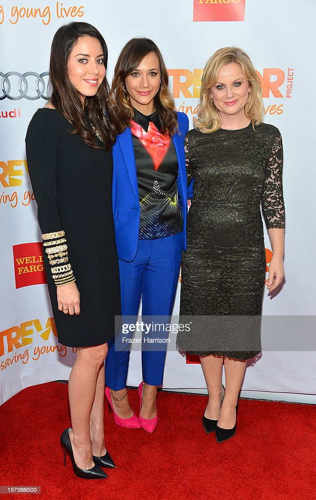 Actors <a gi-track='captionPersonalityLinkClicked' href=/galleries/search?phrase=Aubrey+Plaza&family=editorial&specificpeople=5299268 ng-click='$event.stopPropagation()'>Aubrey Plaza</a>, <a gi-track='captionPersonalityLinkClicked' href=/galleries/search?phrase=Rashida+Jones&family=editorial&specificpeople=2133481 ng-click='$event.stopPropagation()'>Rashida Jones</a>, and <a gi-track='captionPersonalityLinkClicked' href=/galleries/search?phrase=Amy+Poehler&family=editorial&specificpeople=228430 ng-click='$event.stopPropagation()'>Amy Poehler</a> arrive at 'Trevor Live' honoring Katy Perry and Audi of America for The Trevor Project held at The Hollywood Palladium on December 2, 2012 in Los Angeles, California.