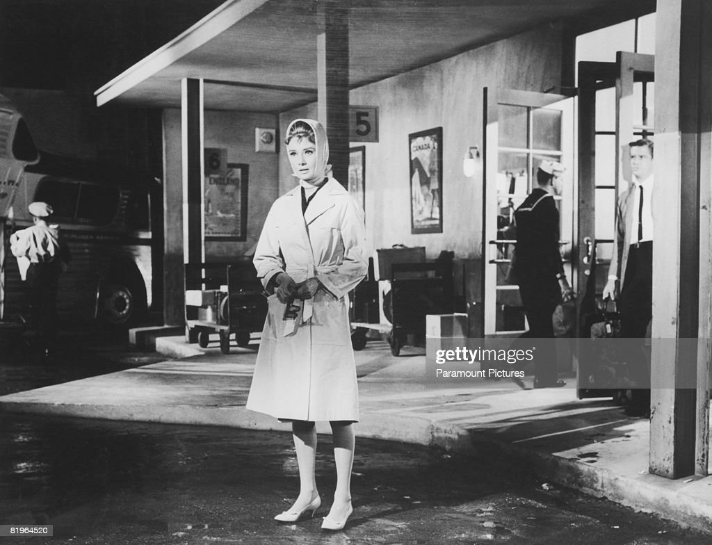 Actors Audrey Hepburn and George Peppard star as Holly Golightly and Paul Varjak in the film 'Breakfast at Tiffany's' 1961 In this scene Holly sees...