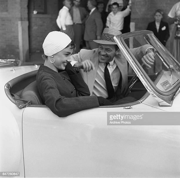 Actors Audrey Hepburn and William Holden in a NashHealey roadster on the set of director Billy Wilder's film 'Sabrina' New York October 1953 Hepburn...