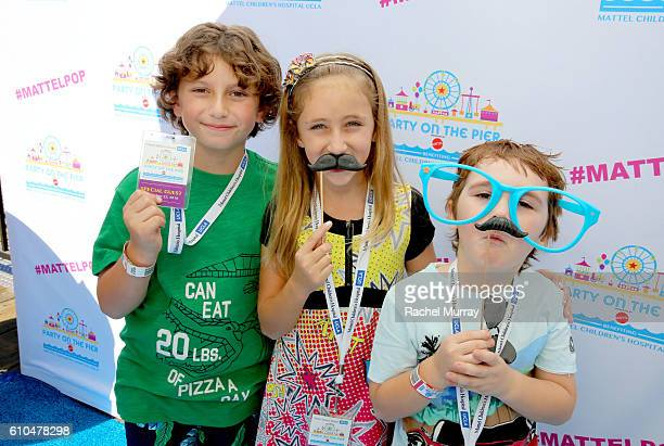 Actors August Maturo Ava Kolker and Cooper Friedman pose at the Autograph Booth during the 17th Annual Mattel Party on the Pier on September 25 2016...