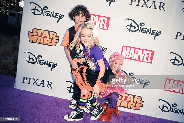 Actors August Maturo Mckenna Grace and Mia Talerico attend Disney's VIP halloween event at Disney Consumer Products Campus on October 1 2014 in...