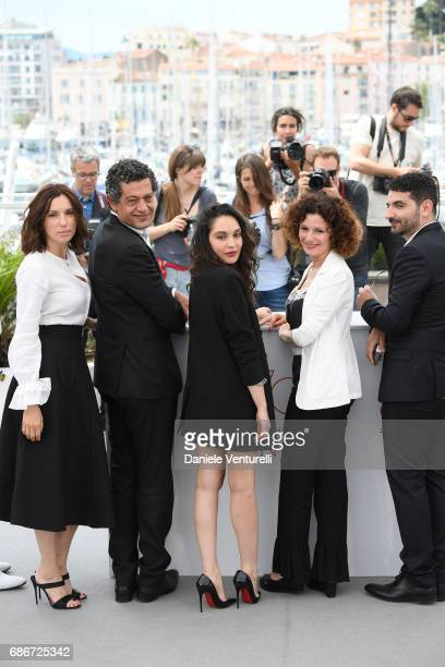 Actors Aure Atika Hassan Kachach Hania Amar Nadia Kaci and Karim Moussaoui and attend 'Waiting For Swallows ' photocall during the 70th annual Cannes...