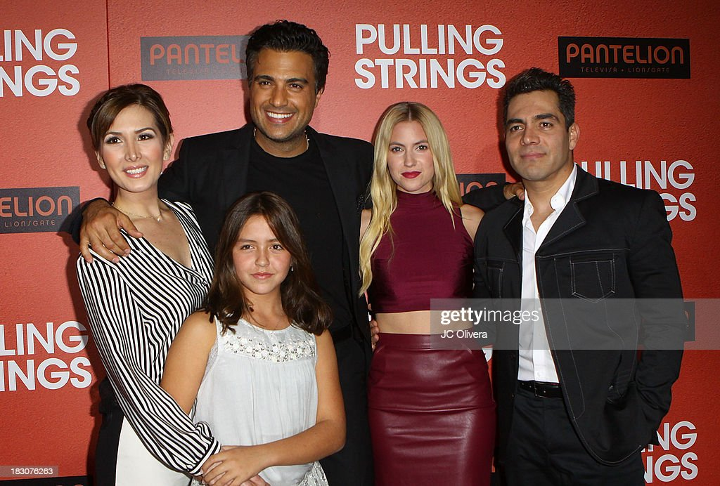 Actors Aurora Papile, <a gi-track='captionPersonalityLinkClicked' href=/galleries/search?phrase=Jaime+Camil&family=editorial&specificpeople=580441 ng-click='$event.stopPropagation()'>Jaime Camil</a>, <a gi-track='captionPersonalityLinkClicked' href=/galleries/search?phrase=Laura+Ramsey&family=editorial&specificpeople=649583 ng-click='$event.stopPropagation()'>Laura Ramsey</a> and Omar Chaparro attend the Los Angeles Premiere of 'Pulling Strings' at Regal Cinemas L.A. Live on October 3, 2013 in Los Angeles, California.