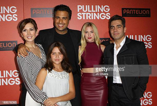 Actors Aurora Papile Jaime Camil Laura Ramsey and Omar Chaparro attend the Los Angeles Premiere of 'Pulling Strings' at Regal Cinemas LA Live on...