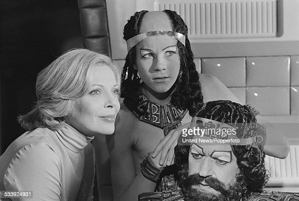 Actors Barbara Bain Michael Gallagher and John Standing pictured together dressed in character on set during filming of the science fiction...