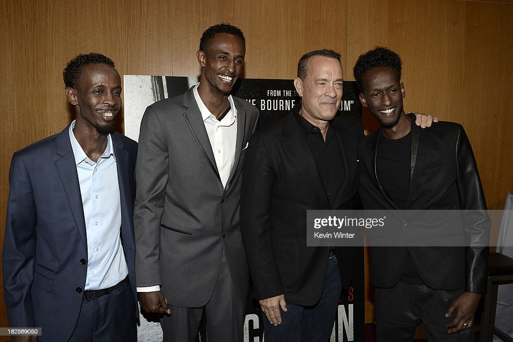 Actors Barkhad Abdi, Faysal Ahmed, <a gi-track='captionPersonalityLinkClicked' href=/galleries/search?phrase=Tom+Hanks&family=editorial&specificpeople=201790 ng-click='$event.stopPropagation()'>Tom Hanks</a> and <a gi-track='captionPersonalityLinkClicked' href=/galleries/search?phrase=Mahat+M.+Ali&family=editorial&specificpeople=11418443 ng-click='$event.stopPropagation()'>Mahat M. Ali</a> arrive at the premiere of Columbia Pictures' 'Captain Phillips' at the Academy of Motion Picture Arts and Sciences on September 30, 2013 in Beverly Hills, California.