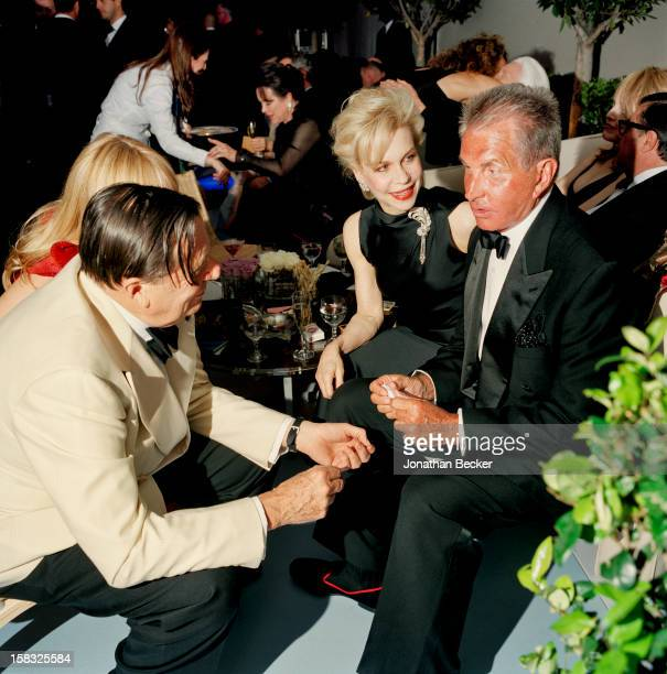 Actors Barrie Humphries Lynn Wyatt and George Hamilton are photographed for Vanity Fair Magazine on March 23 2003 at the Vanity Fair Oscar Party at...