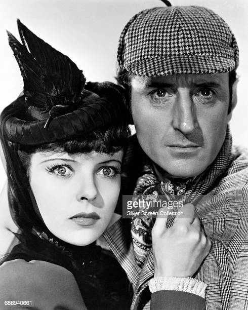 Actors Basil Rathbone as Sherlock Holmes and Ida Lupino as Ann Brandon in a publicity still for the film 'The Adventures of Sherlock Holmes' 1939
