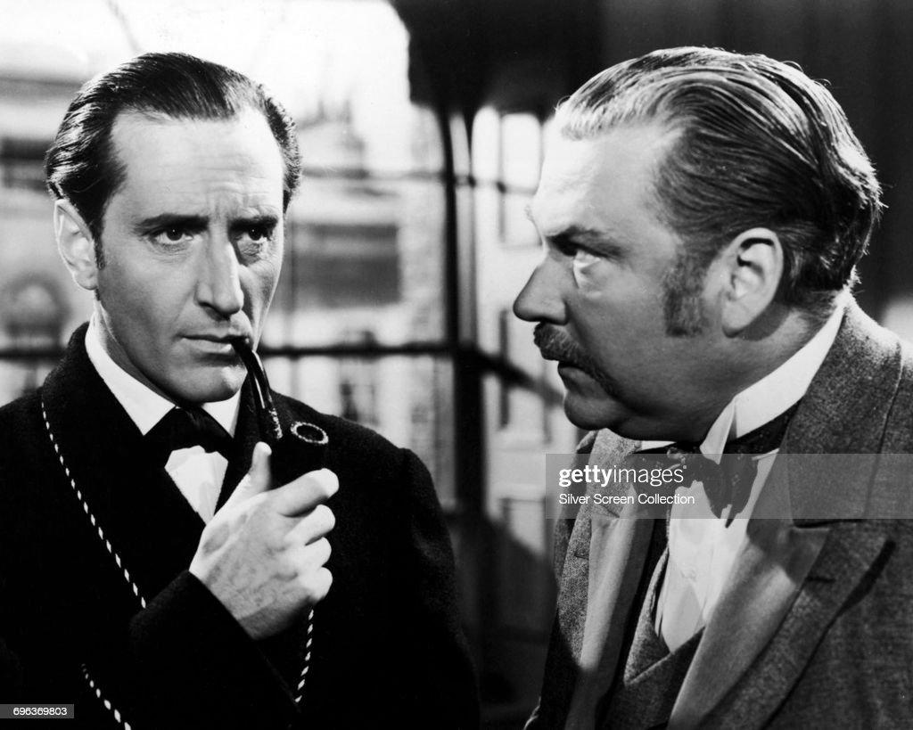 Actors Basil Rathbone (left) as Sherlock Holmes and Nigel Bruce as Doctor Watson in the film 'The Adventures of Sherlock Holmes', 1939.
