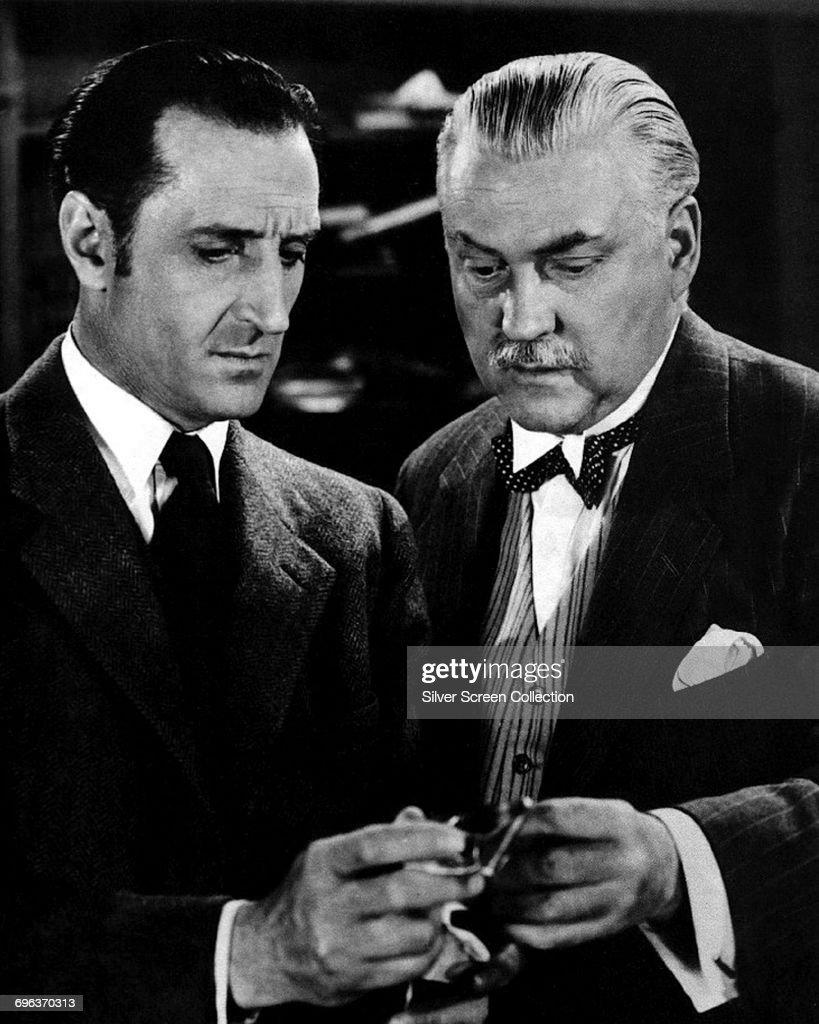 Actors Basil Rathbone (left) as Sherlock Holmes and Nigel Bruce as Doctor Watson in the Sherlock Holmes film series, circa 1940.