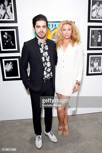 Actors Beejan Land and Claudia Black attend Best Buddies 'The Art of Friendship' Benefit Photo Auction hosted by De Re Gallery on March 3 2016 in...