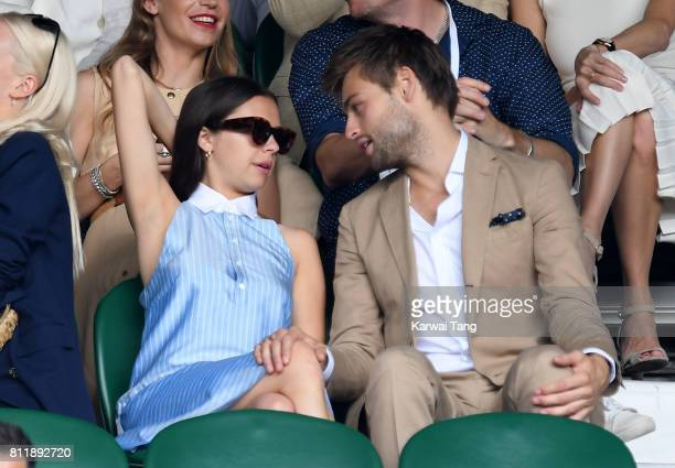 Actors Bel Powley and Douglas Booth attend day seven of the Wimbledon Tennis Championships at the All England Lawn Tennis and Croquet Club on July 10...