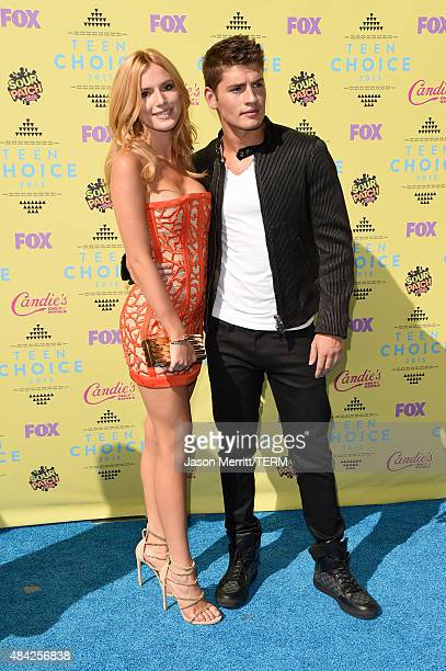 Actors Bella Thorne and Gregg Sulkin attend the Teen Choice Awards 2015 at the USC Galen Center on August 16 2015 in Los Angeles California