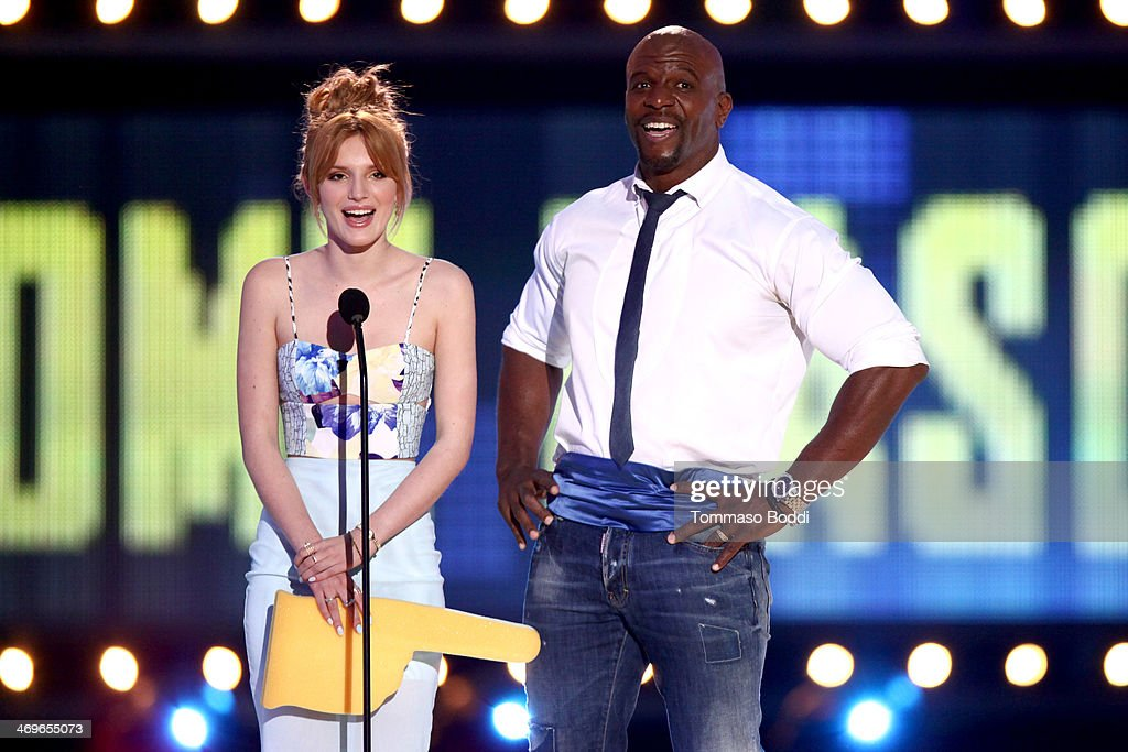 Actors Bella Thorne (L) and Terry Crews speak onstage during the 4th Annual Cartoon Network Hall Of Game Awards held at the Barker Hangar on February 15, 2014 in Santa Monica, California.