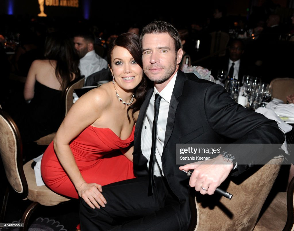 Actors Bellamy Young (L) and Scott Foley attend the 16th Costume Designers Guild Awards with presenting sponsor Lacoste at The Beverly Hilton Hotel on February 22, 2014 in Beverly Hills, California.