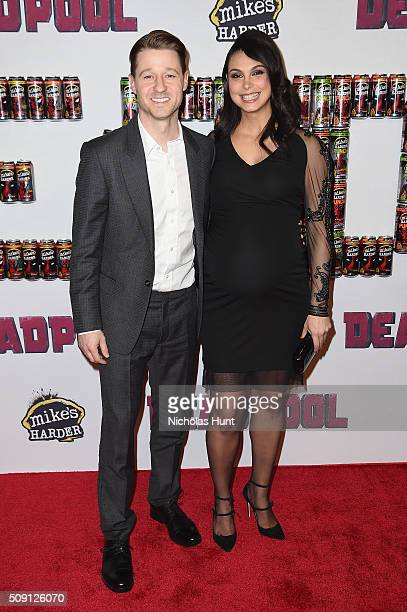 Actors Ben McKenzie and Morena Baccarin attend the 'Deadpool' fan event at AMC Empire Theatre on February 8 2016 in New York City