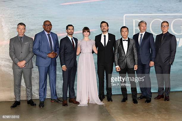 Actors Ben Mendelsohn Forest Whitaker Riz Ahmed Felicity Jones Diego Luna Donnie Yen Mads Mikkelsen and Alan Tudyk attend the launch event for 'Rogue...