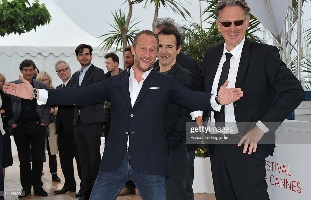 Actors Benoit Poelvoorde, <a gi-track='captionPersonalityLinkClicked' href=/galleries/search?phrase=Albert+Dupontel&family=editorial&specificpeople=3096344 ng-click='$event.stopPropagation()'>Albert Dupontel</a> and director Benoit Delepine at the 'Le Grand Soir' photocall during the 65th Annual Cannes Film Festival at Palais des Festivals on May 22, 2012 in Cannes, France.