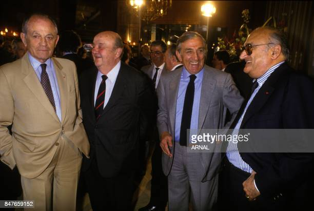 Actors Bernard Blier and Lino Ventura with director Henri Verneuil at party for the 50th anniversary of Cinecitta studios in 1987 in Rome Italy