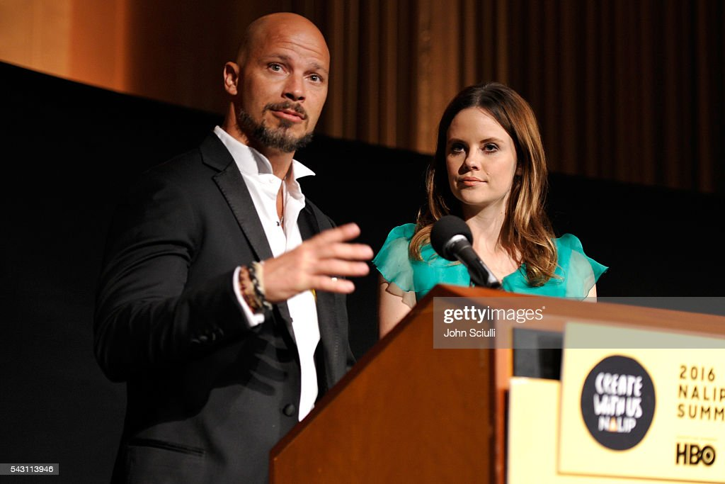 Actors Berto Colon and Sarah Ramos speak onstage during the NALIP 2016 Latino Media Awards at Dolby Theatre on June 25, 2016 in Hollywood, California.