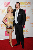 Actors Beth Behrs and husband Michael Gladis arrive at TrevorLIVE Los Angeles at Hollywood Palladium on December 7 2014 in Los Angeles California