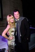 Actors Beth Behrs and Michael Gladis pose on the red carpet during Philadelphia Style Magazine's Holiday Issue Party at Trust on December 19 2013 in...