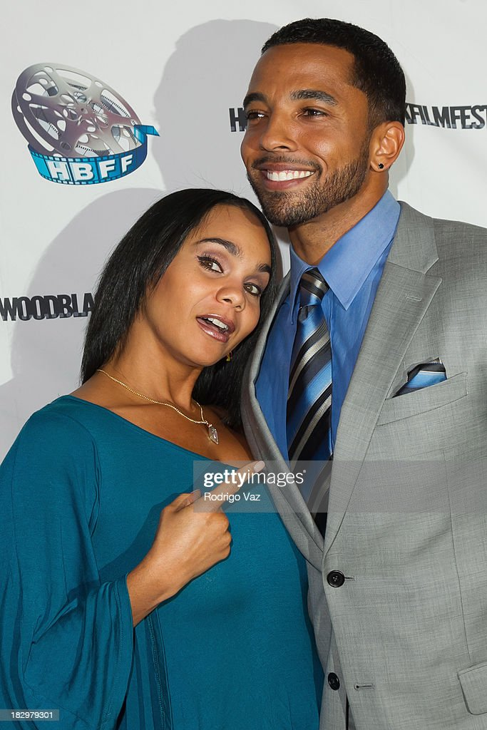 Actors Beth Payne (L) and Christian Keyes attend the Opening Night for the Hollywood Black Film Festival (HBFF) Arrivals at The Ricardo Montalban Theatre on October 2, 2013 in Hollywood, California.