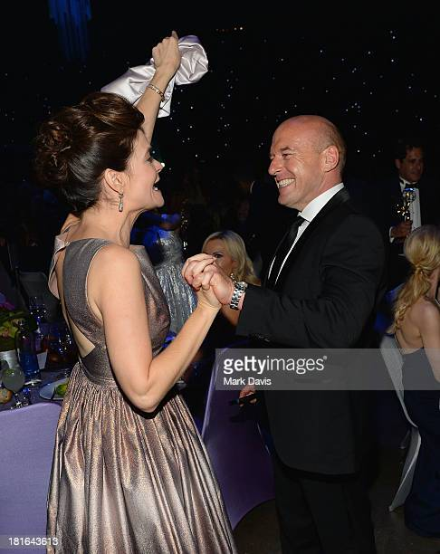 Actors Betsy Brandt and Dean Norris attend the Governors Ball during the 65th Annual Primetime Emmy Awards at Nokia Theatre LA Live on September 22...