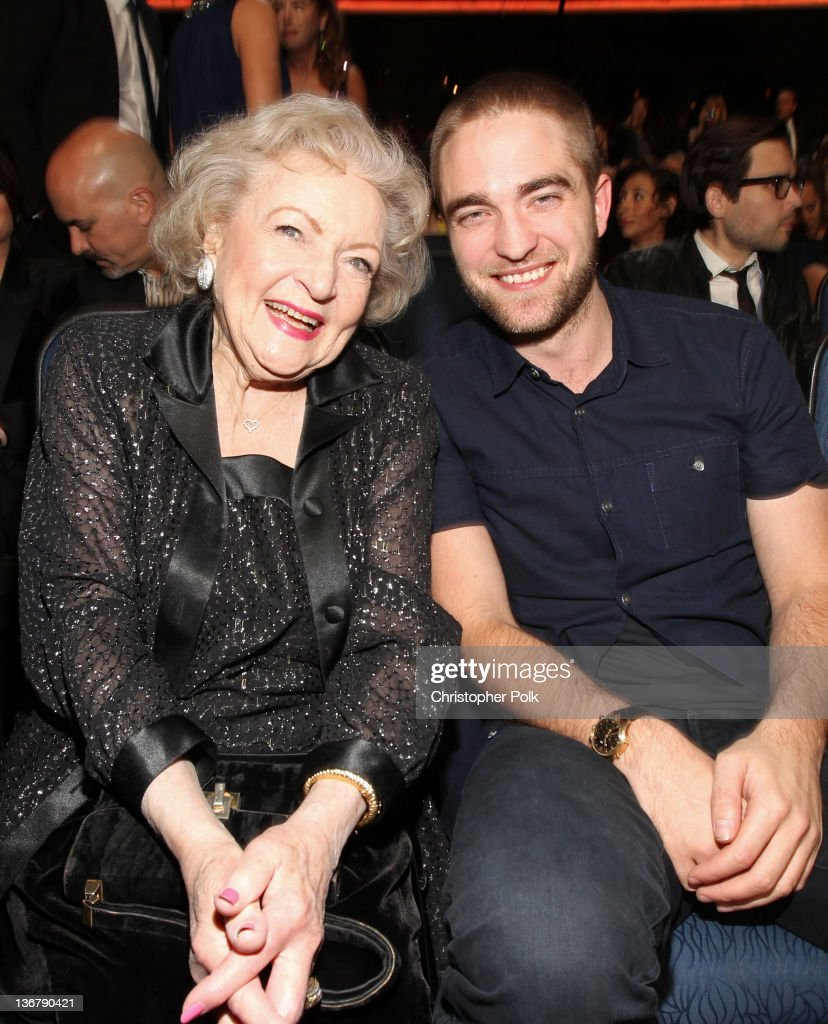 Actors Betty White and Robert Pattinson pose in the audience during the 2012 People's Choice Awards at Nokia Theatre L.A. Live on January 11, 2012 in Los Angeles, California.