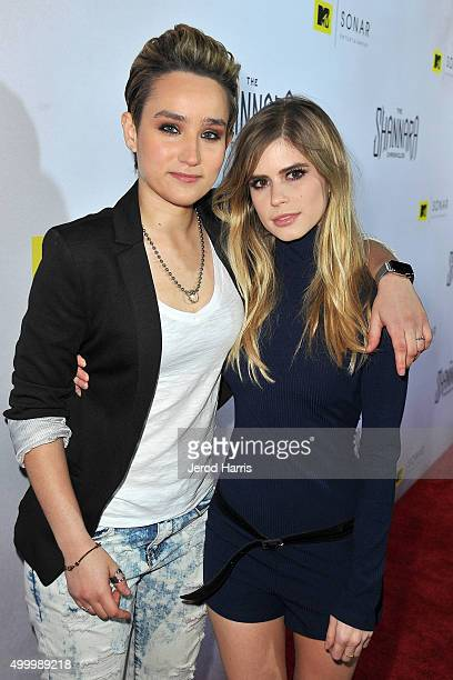 Actors Bex TaylorKlaus and Carlson Young attend the series premiere party for 'The Shannara Chronicles' On MTV at iPic Theaters on December 4 2015 in...