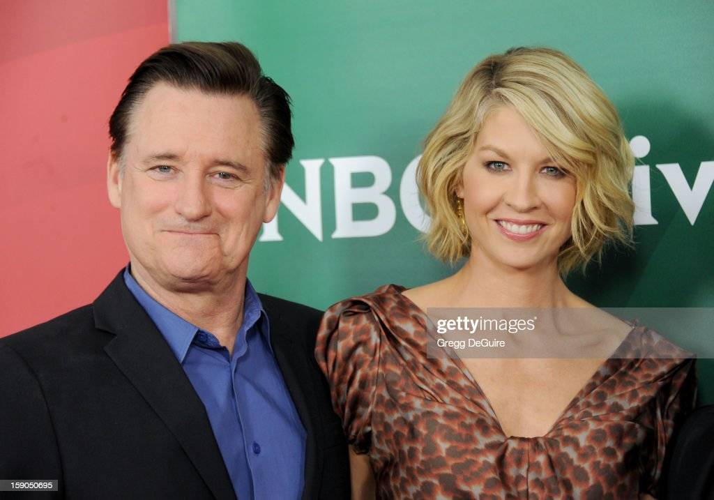 Actors <a gi-track='captionPersonalityLinkClicked' href=/galleries/search?phrase=Bill+Pullman&family=editorial&specificpeople=226899 ng-click='$event.stopPropagation()'>Bill Pullman</a> and <a gi-track='captionPersonalityLinkClicked' href=/galleries/search?phrase=Jenna+Elfman&family=editorial&specificpeople=204782 ng-click='$event.stopPropagation()'>Jenna Elfman</a> pose at the 2013 NBC Universal TCA Winter Press Tour Day 1 at The Langham Huntington Hotel and Spa on January 6, 2013 in Pasadena, California.