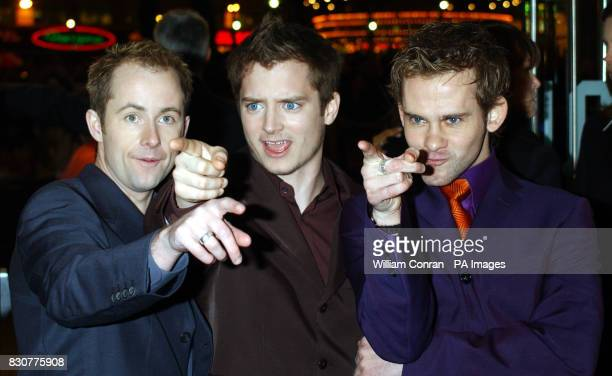 Actors Billy Boyd Elijah Wood and Dominic Monaghan arrive at the Odeon Leicester Square in London for the world premiere of their latest film Lord of...