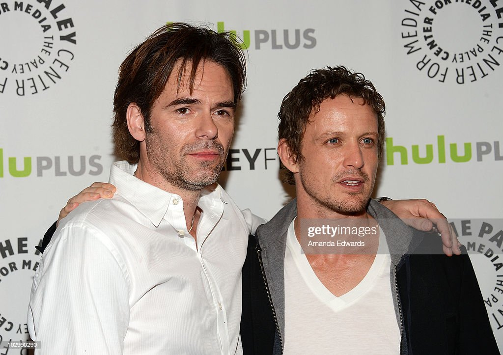 Actors Billy Burke (L) and David Lyons arrive at the 30th Annual PaleyFest: The William S. Paley Television Festival featuring 'Revolution' at Saban Theatre on March 2, 2013 in Beverly Hills, California.