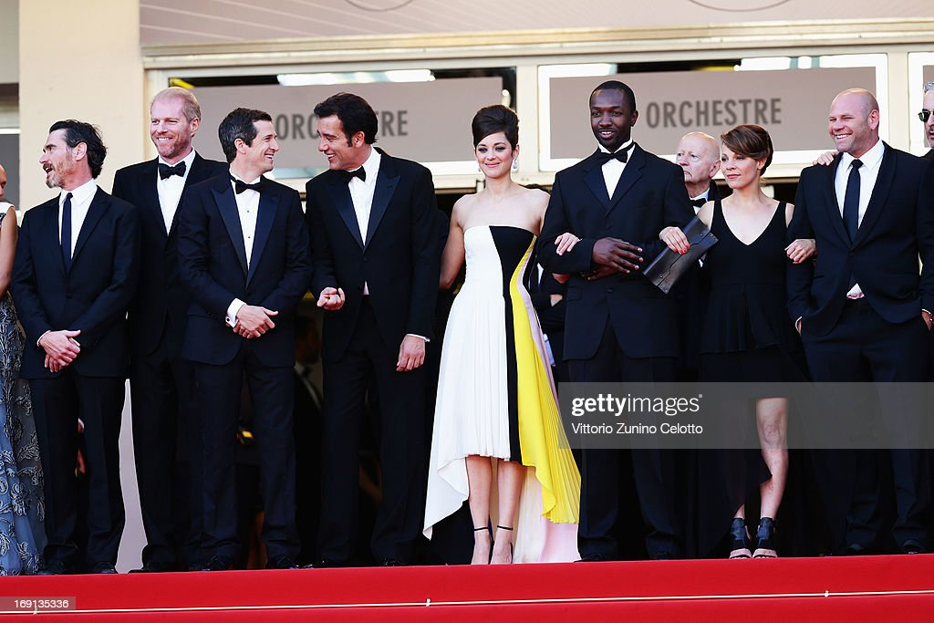 Actors Billy Crudup and Noah Emmerich, director Guillaume Canet and actors Clive Owen, Marion Cotillard, Jamie Hector, Lili Taylor and Domenick Lombardozzi attend the 'Blood Ties' Premiere during the 66th Annual Cannes Film Festival at the Palais des Festivals on May 20, 2013 in Cannes, France.