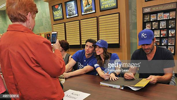 Actors Billy Flynn Kate Mansi pose for pictures while Greg Vaughan signs a book during the Days Of Our Lives book signing at the Oak Park Mall Barnes...