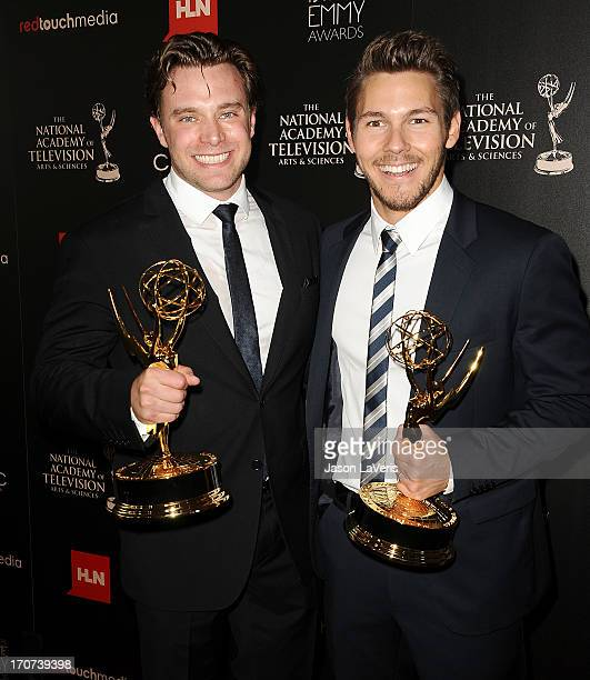 Actors Billy Miller and Scott Clifton pose in the press room at the 40th annual Daytime Emmy Awards at The Beverly Hilton Hotel on June 16 2013 in...