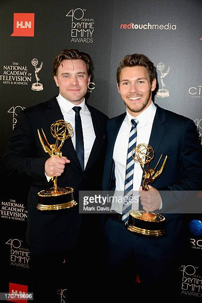 Actors Billy Miller and Scott Clifton pose with the Outstanding Supporting Actor in a Drama Series award for 'The Young and the Restless' and 'The...