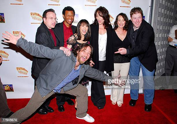 Actors Billy West Phil LaMarr Lauren Tom Katey Sagal Tress MacNeille John DiMaggio and David Herman pose at the premiere screening of the new DVD...