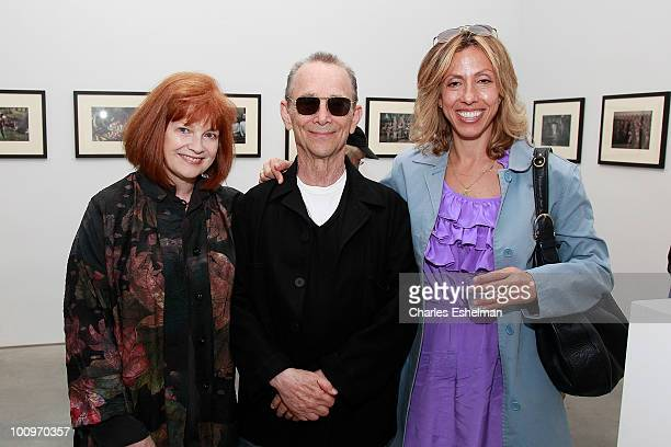 Actors Blair Brown Joel Grey and singer/songwriter Amanda Green attend attends the photography exhibition opening for '13 New Color Images by Joel...