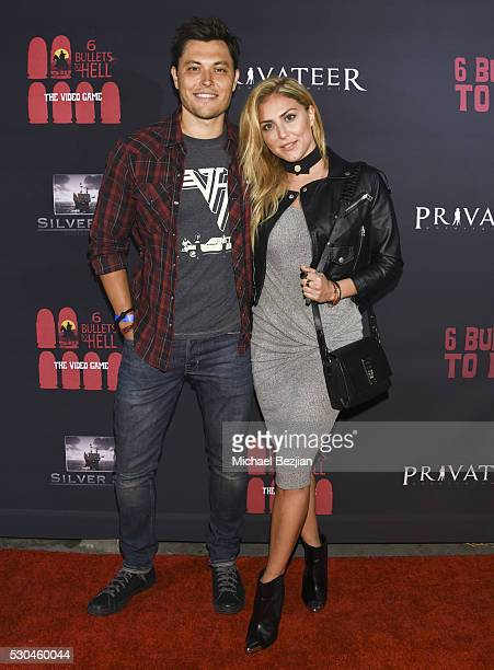 Actors Blair Redford and Cassie Scerbo arrive at the '6 Bullets To Hell' Mobile Game Launch Party on May 10 2016 in Los Angeles California