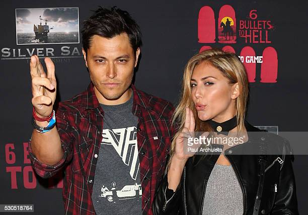 Actors Blair Redford and Cassie Scerbo attend the launch of '6 Bullets To Hell' the video game and the movie on May 10 2016 in Los Angeles California
