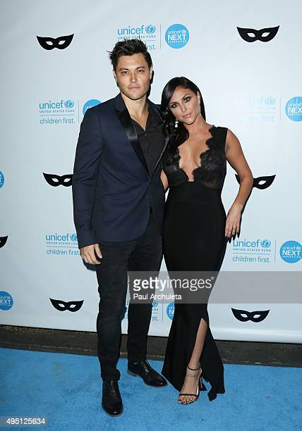 Actors Blair Redford and Cassie Scerbo attend the UNICEF Black White masquerade ball at The Masonic Lodge at Hollywood Forever on October 30 2015 in...