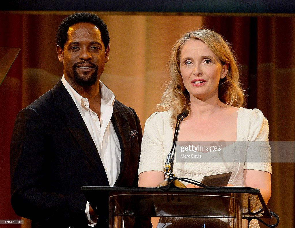 Actors <a gi-track='captionPersonalityLinkClicked' href=/galleries/search?phrase=Blair+Underwood&family=editorial&specificpeople=215367 ng-click='$event.stopPropagation()'>Blair Underwood</a> and <a gi-track='captionPersonalityLinkClicked' href=/galleries/search?phrase=Julie+Delpy&family=editorial&specificpeople=201914 ng-click='$event.stopPropagation()'>Julie Delpy</a> speak onstage at the Hollywood Foreign Press Association's 2013 Installation Luncheon at The Beverly Hilton Hotel on August 13, 2013 in Beverly Hills, California.