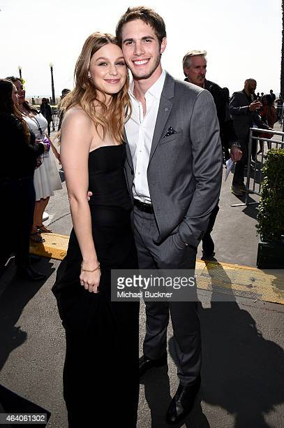 Actors Blake Jenner and Melissa Benoist pose outside the FIJI Water tent during the 30th Annual Film Independent Spirit Awards at Santa Monica Beach...