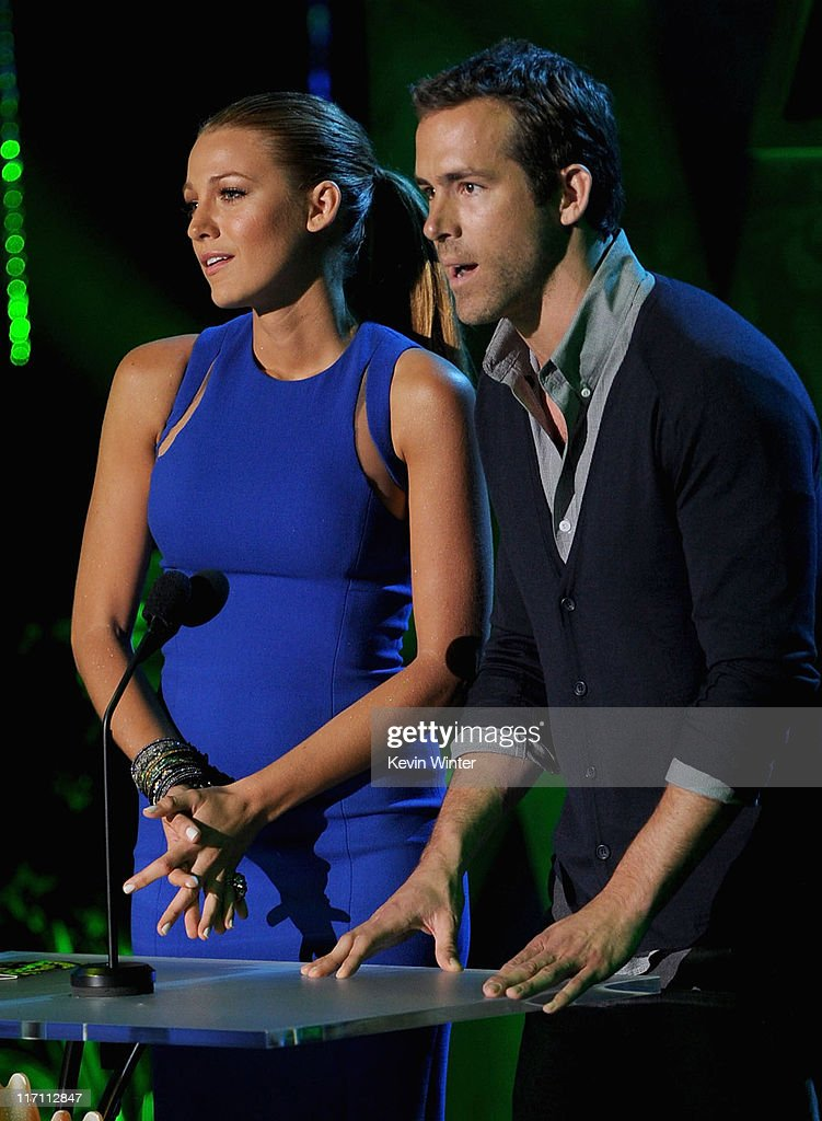 Actors <a gi-track='captionPersonalityLinkClicked' href=/galleries/search?phrase=Blake+Lively&family=editorial&specificpeople=221673 ng-click='$event.stopPropagation()'>Blake Lively</a> (L) and <a gi-track='captionPersonalityLinkClicked' href=/galleries/search?phrase=Ryan+Reynolds&family=editorial&specificpeople=204149 ng-click='$event.stopPropagation()'>Ryan Reynolds</a> speak onstage during the 2011 MTV Movie Awards at Universal Studios' Gibson Amphitheatre on June 5, 2011 in Universal City, California.