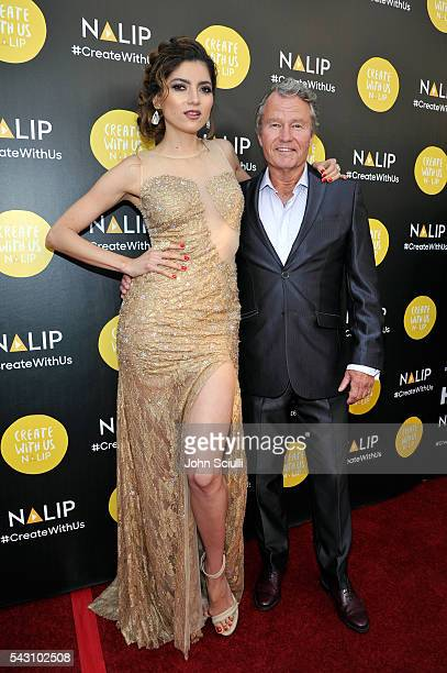 Actors Blanca Blanco and John Savage attend the NALIP 2016 Latino Media Awards at Dolby Theatre on June 25 2016 in Hollywood California