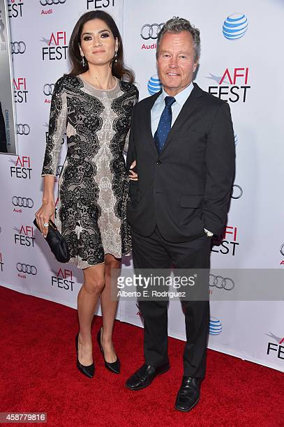 Actors Blanca Blanco and John Savage attend the screening of 'The Gambler' during the AFI FEST 2014 presented by Audi at Dolby Theatre on November 10...