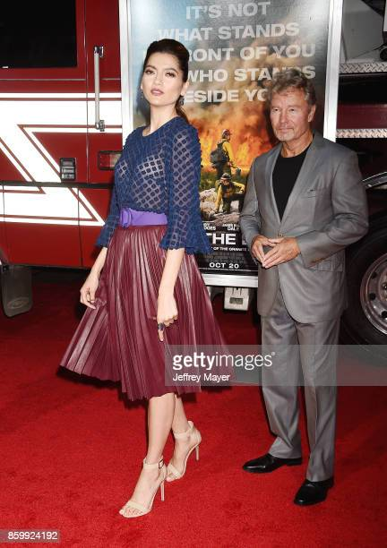 Actors Blanca Blanco John Savage arrives at the Premiere Of Columbia Pictures' 'Only The Brave' at Regency Village Theatre on October 8 2017 in...